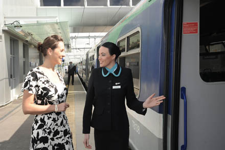 Aer Arann Regional cabin crew member Kerry Crozier pictured helping passenger Emer Kelly from Tramore, Co. Waterford who was in London on Tuesday to celebrate the opening of the London Southend Airport railway station.